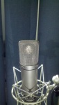 Neumann u87 condenser microphone rear view with mic element reflection and spider shockmount